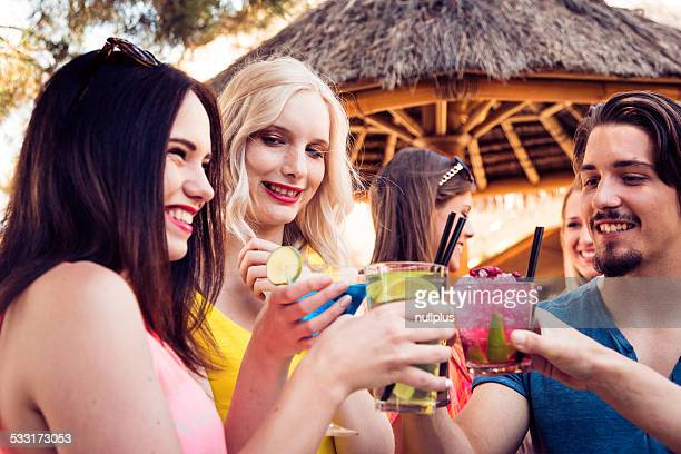 friends enjoying cocktails at a party