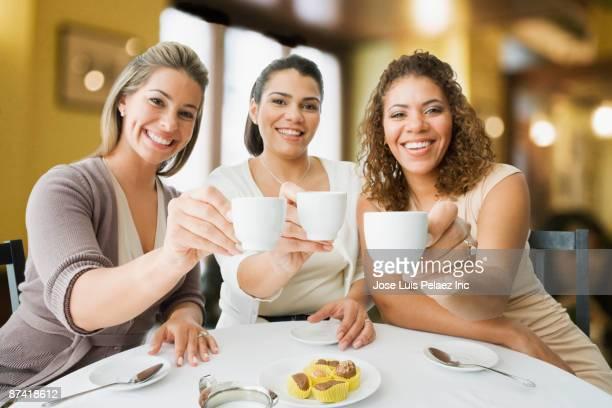 Friends enjoying coffee in cafe