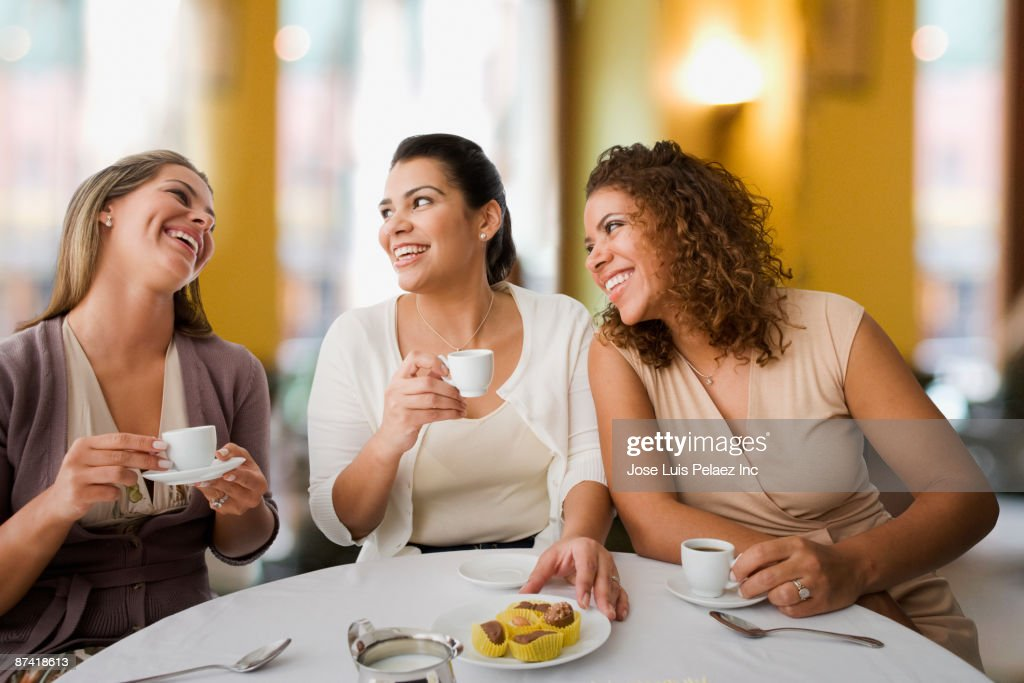 Friends enjoying coffee in cafe : Stock Photo