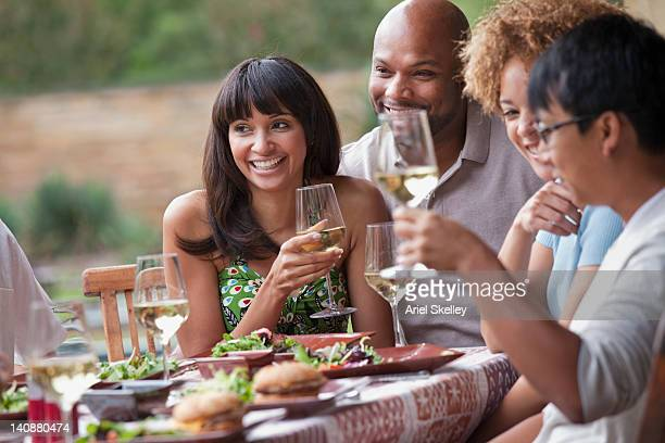 Friends enjoying meal together outdoors