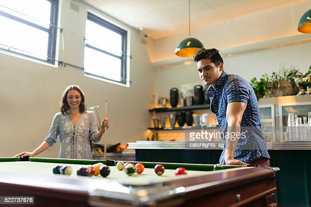 Friends Enjoying Pool Game in a Bar
