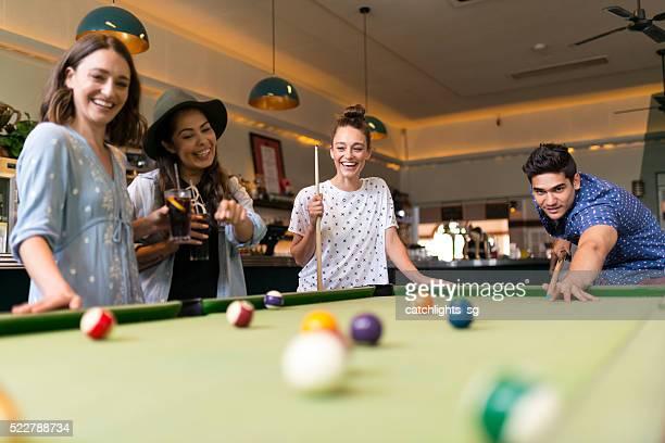 Friends Enjoying Pool Game in a Bar
