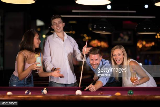 friends enjoying pool game