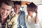Friends enjoying road trip in a camper van