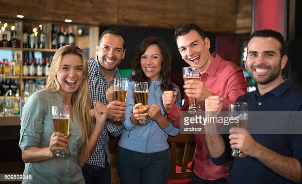 Friends enjoying the happy hour at a bar