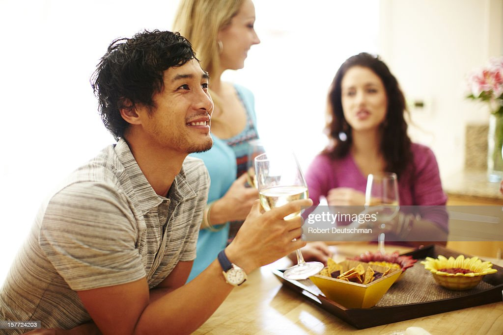 Friends enjoying wine together. : Stock Photo