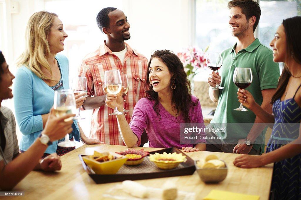Friends enjoying wine together. : Stock Photo