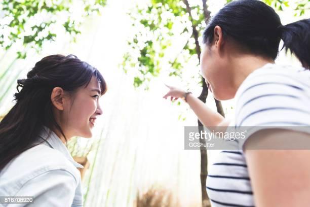 Friends exploring Arashiyama district in Kyoto, Japan