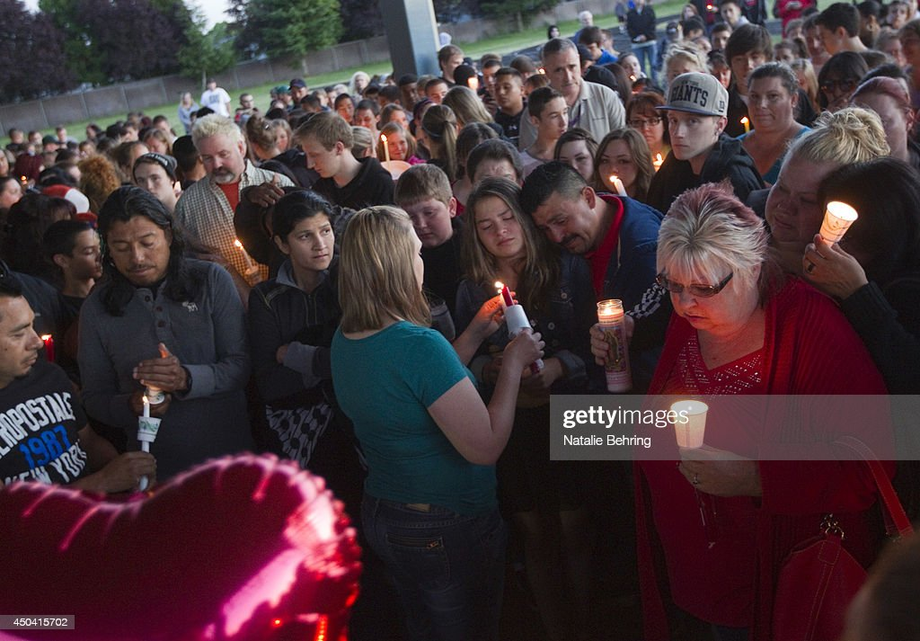 Friends, family and well-wishers hold candles for Emilio Hoffman, the victim of today's school shooting at a vigil on June 10, 2014 in Troutdale, Oregon. A gunman walked into Reynolds High School with a rifle and shot 14 year old Hoffman to death on Tuesday, in what is the the third outbreak of gun violence in a U.S. school in less than three weeks.
