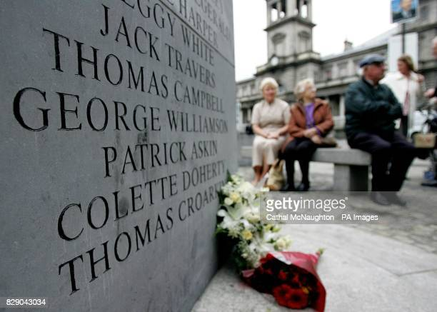 Friends family members and wellwishers pay their respects at a 30th anniversary memorial service on Talbot Street Dublin where friends and family...