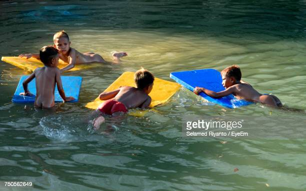 Friends Floating On Water At Water Park