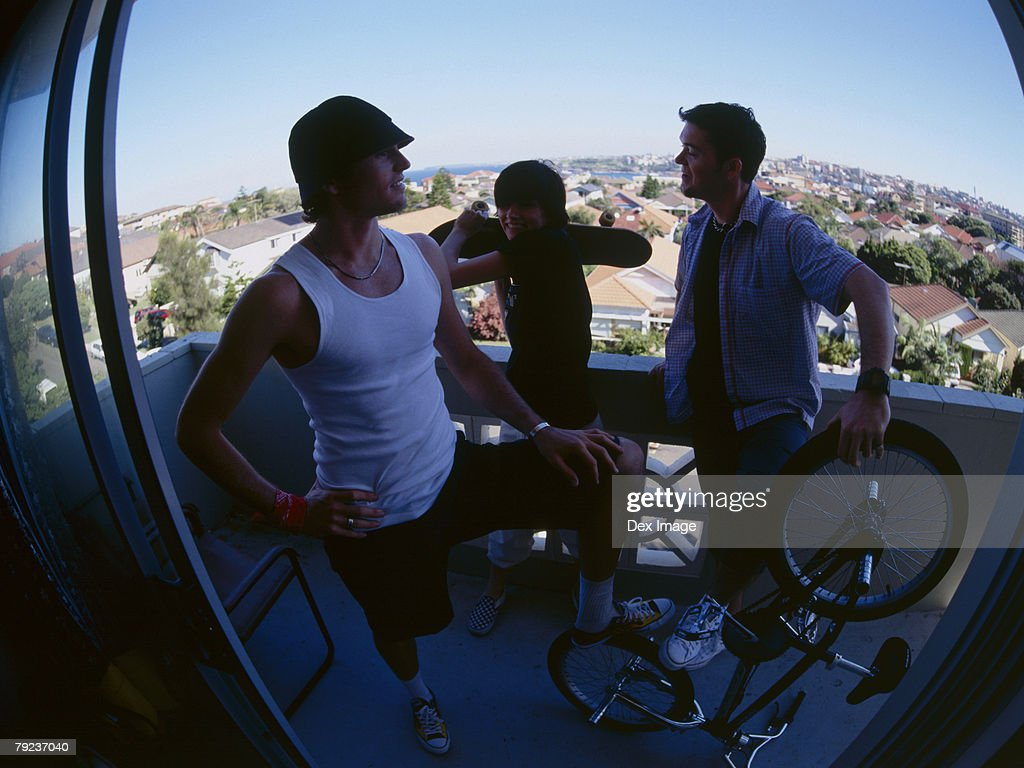 Friends gather at balcony : Stock Photo
