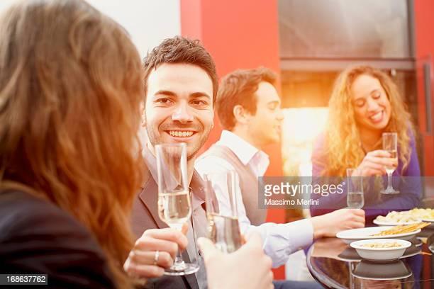 friends give toast over Italian aperitif