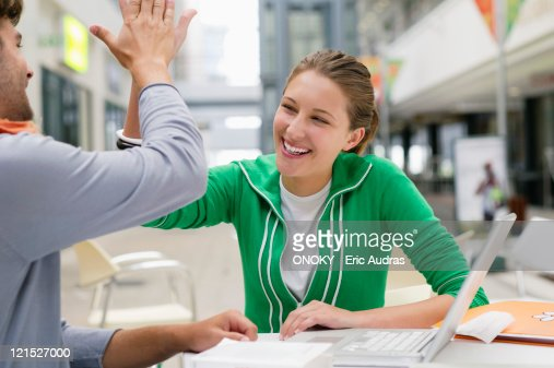 Friends giving each other high-five : Stock Photo