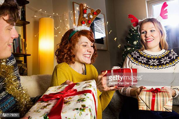 Friends giving presents at Christmas.