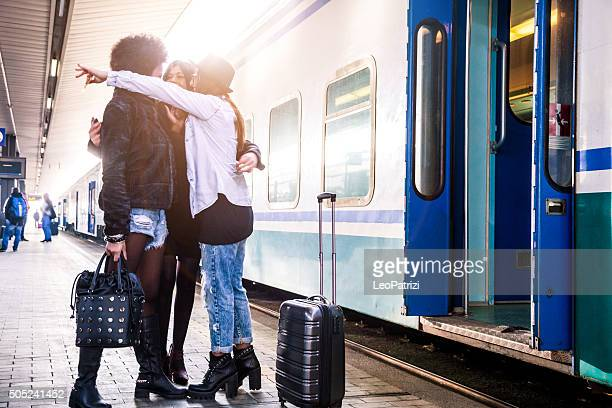 Friends greet at the train station before departure