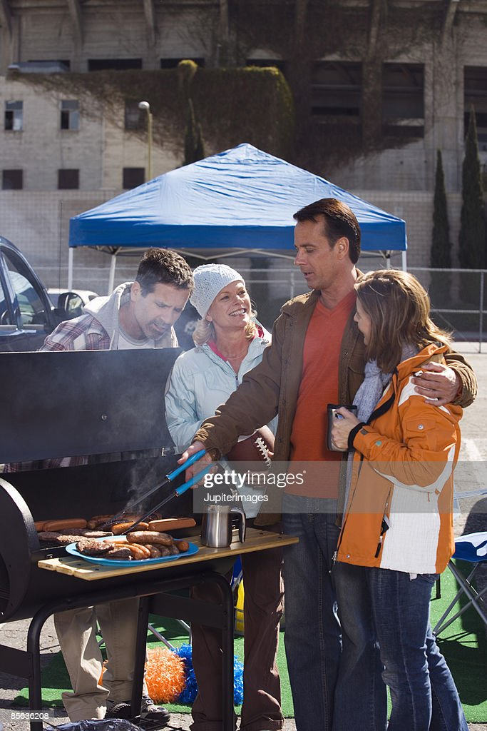 Friends grilling at tailgate party : Stock Photo