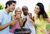 Friends grilling food
