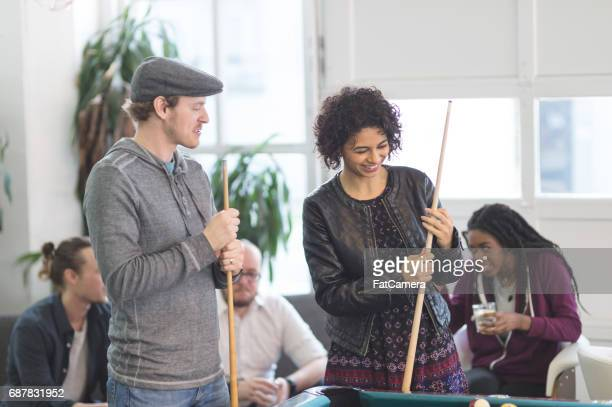 Friends hang out and play some pool together