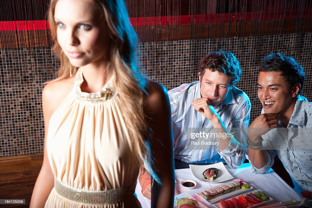 Friends hanging out at a club eating : Stock Photo