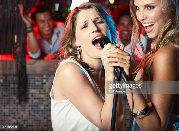 Friends hanging out at a club singing