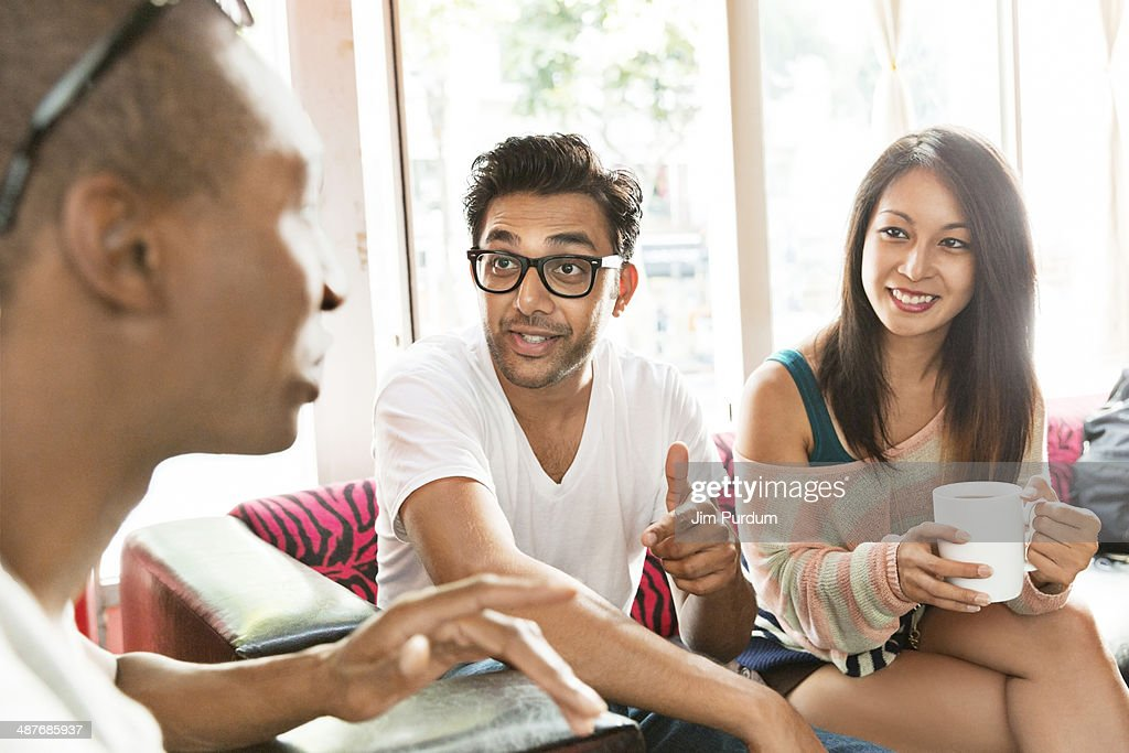 Friends hanging out at cafe : Stock Photo