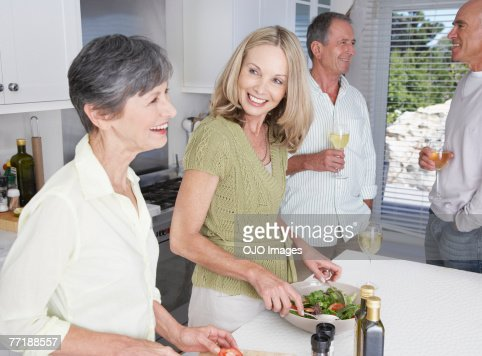 Friends hanging out in a kitchen : Stock Photo