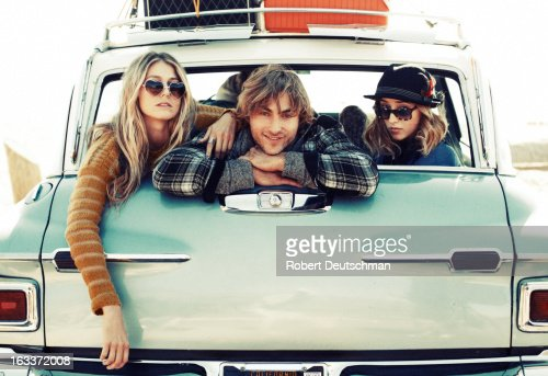 Friends hanging out in the back of a car. : Stock Photo