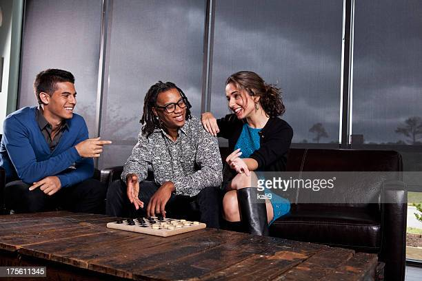 Friends hanging out, playing checkers