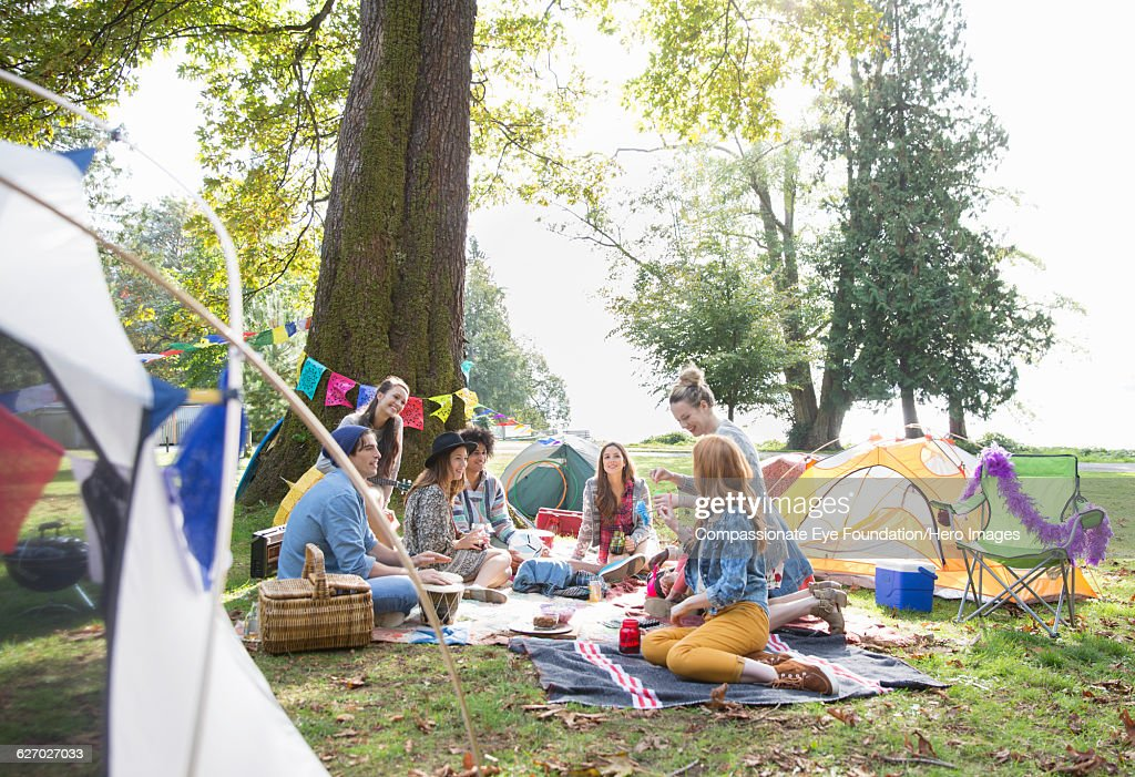 Friends hanging out relaxing at Music Festival : Stock Photo