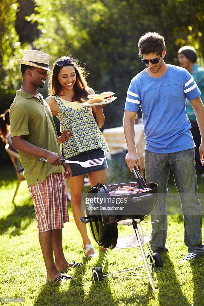 Friends having a BBQ.