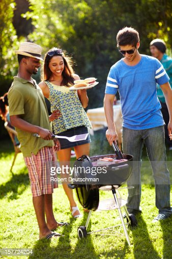 Friends having a BBQ. : Stock Photo