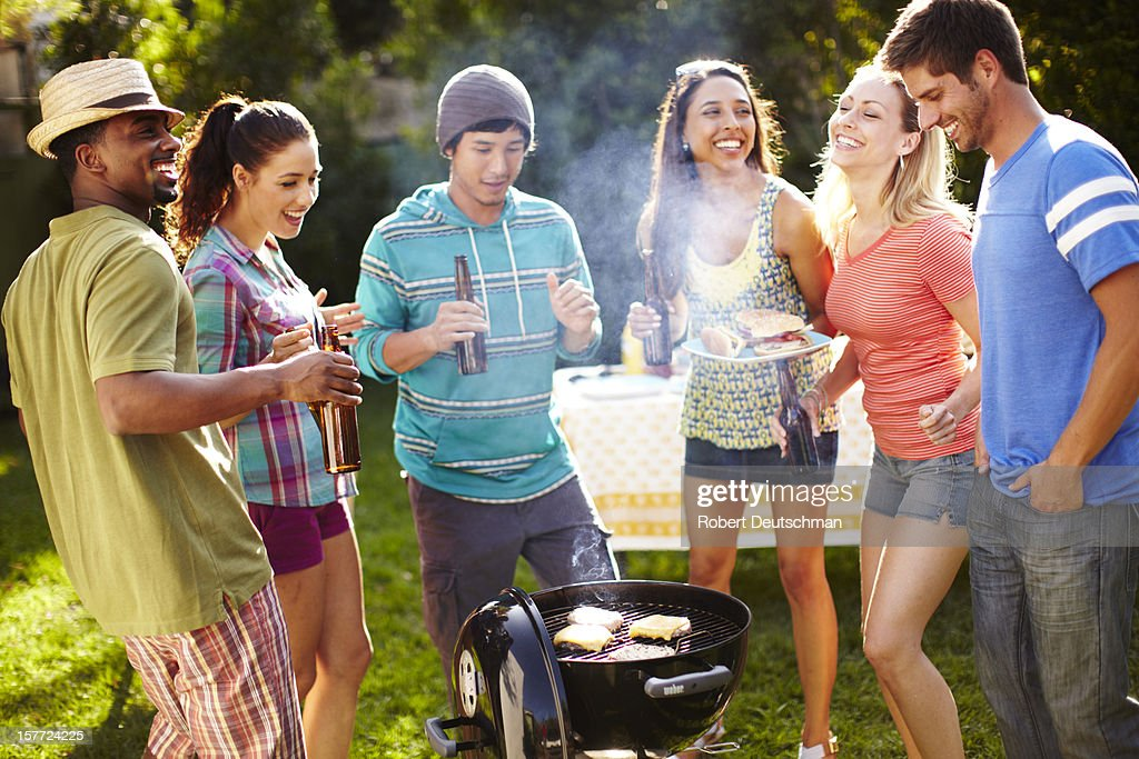 Friends having a BBQ with drinks. : Stock Photo