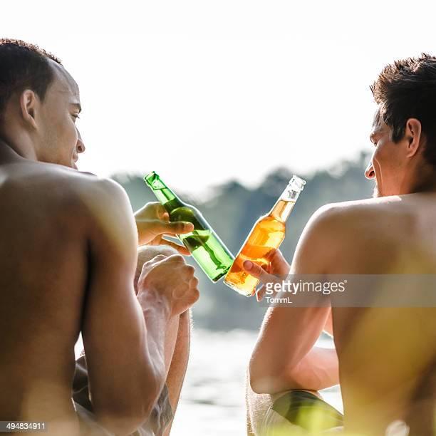Friends Having A Beer At A Lake