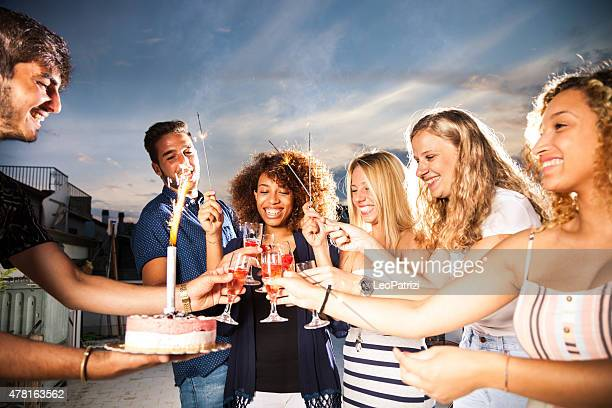 Friends having a lot of fun at birthday party