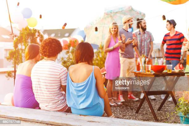Friends having a party on rooftop