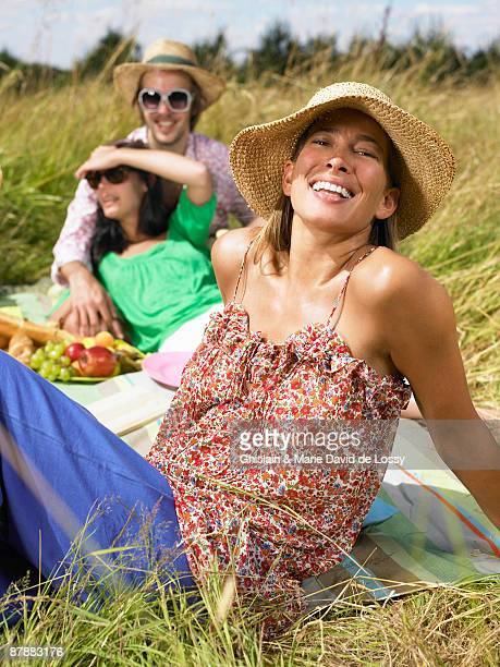 Friends having a picnic in a field