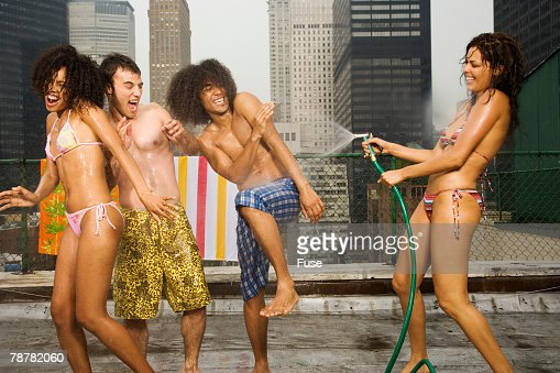 Friends Having a Water Fight on Rooftop