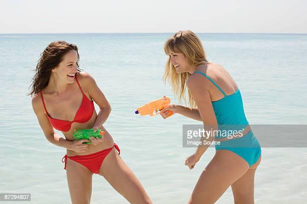 Friends having a water fight
