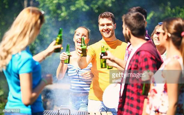 Friends having backyard party.