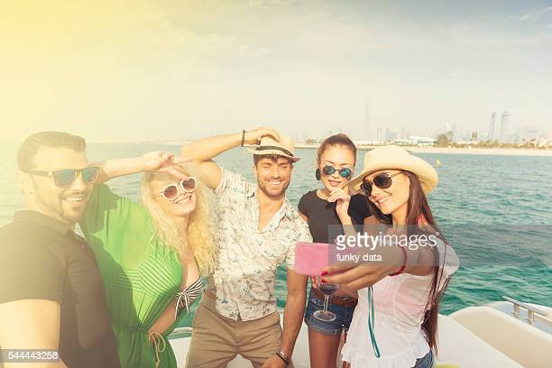 Friends having boat party in Dubai