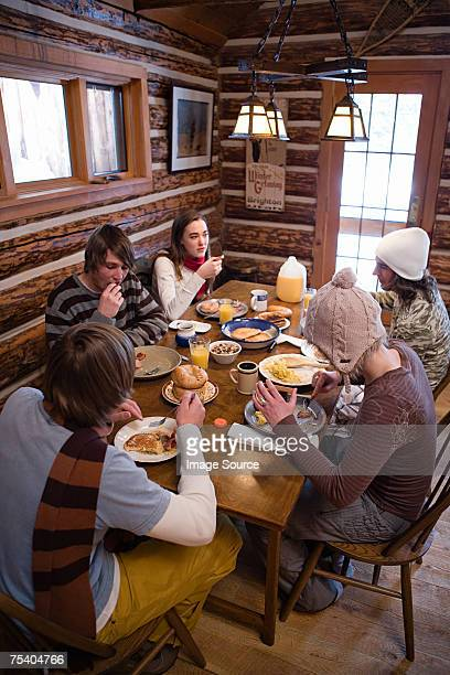 Friends having breakfast in chalet