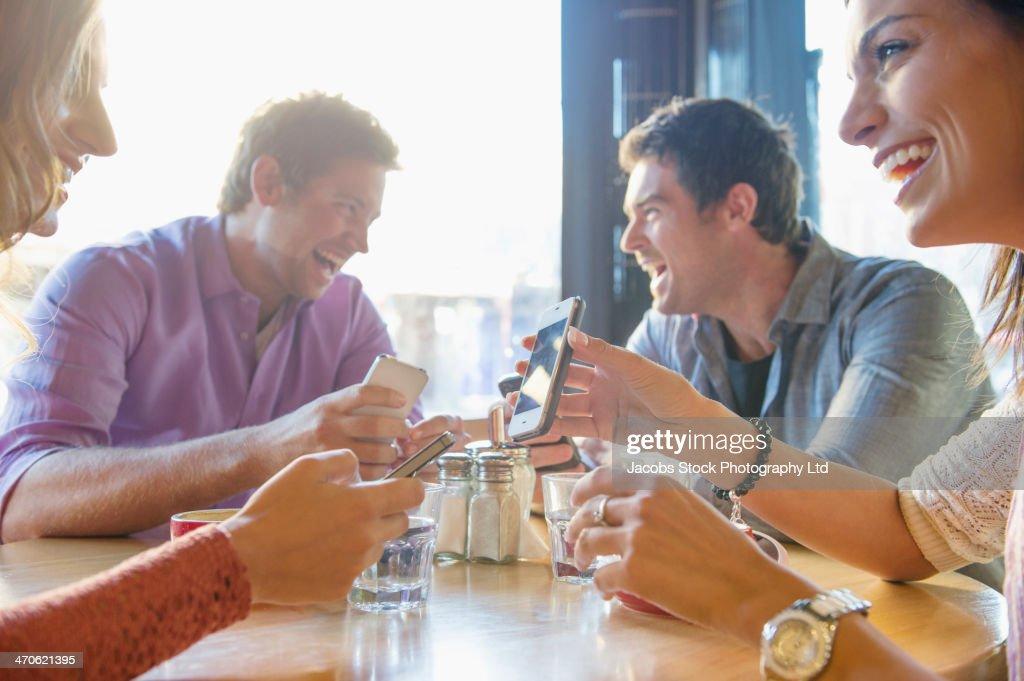 Friends having coffee in cafe