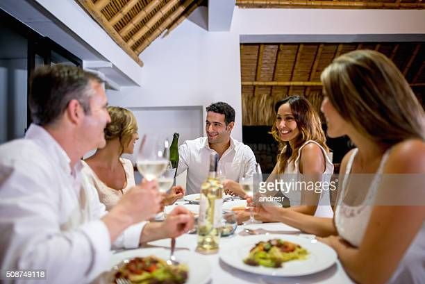 Friends having dinner and making a toast