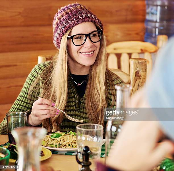 Friends Having Dinner in Cabin