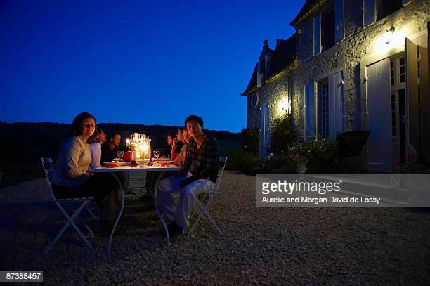Friends having dinner outside