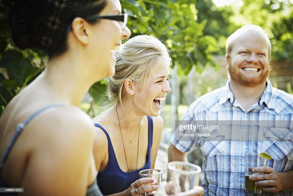 Friends having drinks and laughing together