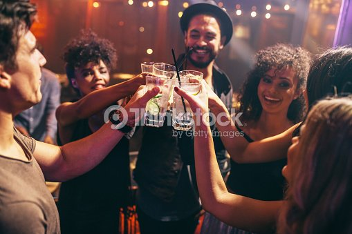Friends having drinks at the night club party : Stock Photo