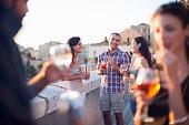 Friends having drinks on balcony
