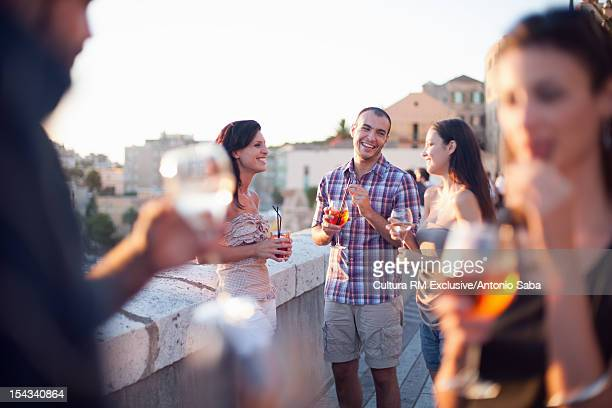 Friends having drinks on balcony